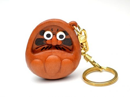 TUMBLING DOLL LEATHER KEYCHAIN VANCA